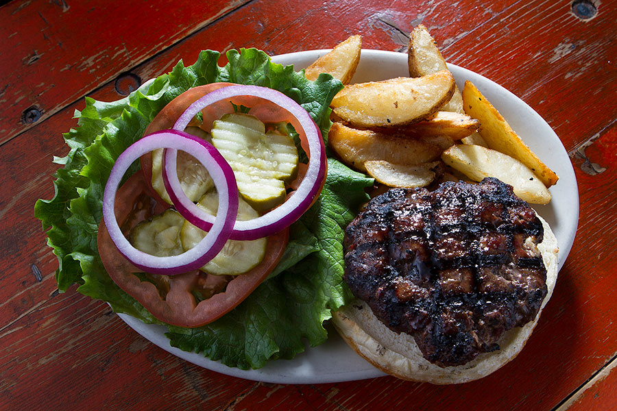 Phoenix Saloon's thick and juicy premium Angus Burgers cooked to order.