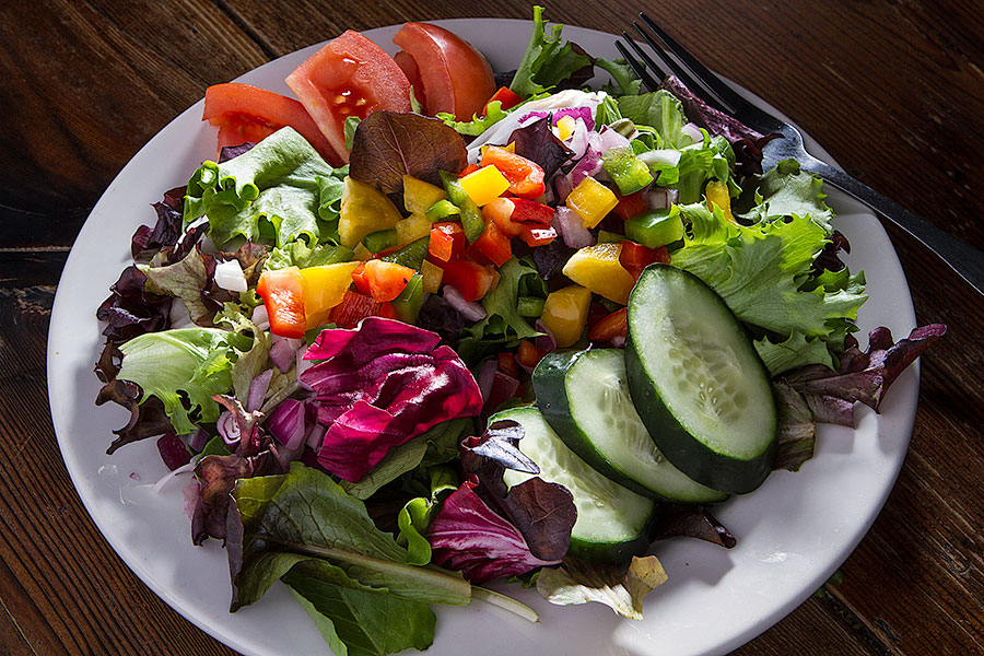 Try our Phoenix Signature Salad - a colorful blend of fresh field greens, cucumbers, purple onions, bell peppers, and tomatoes tossed lightly in one of our homemade dressings.