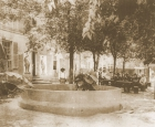 Looking west, this is the left wall of the Phoenix Saloon with San Antonio Street beyond the trees.  This fountain first appears in a Sanborn Insurance map of September 1891.